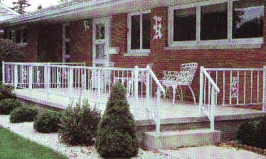 Standard Railing With Fourteen Posts, On A Concrete Patio With Steps.